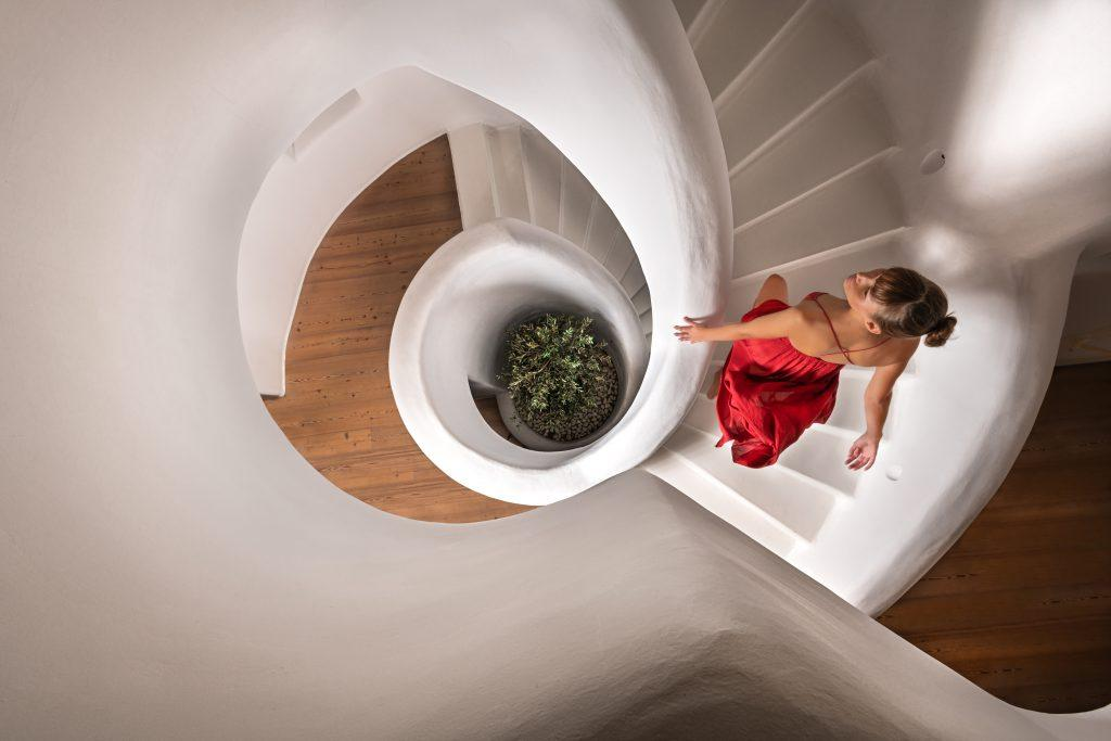 white stairs that go into circle on multifloors