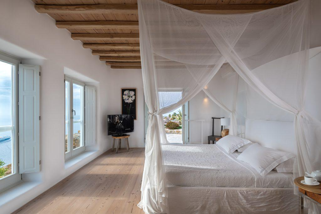 big bedroom with white sheets and pillows