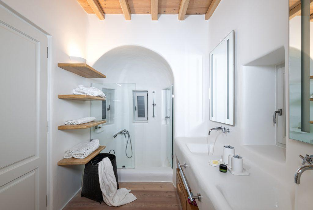 modern designed bathroom with shower and big mirror