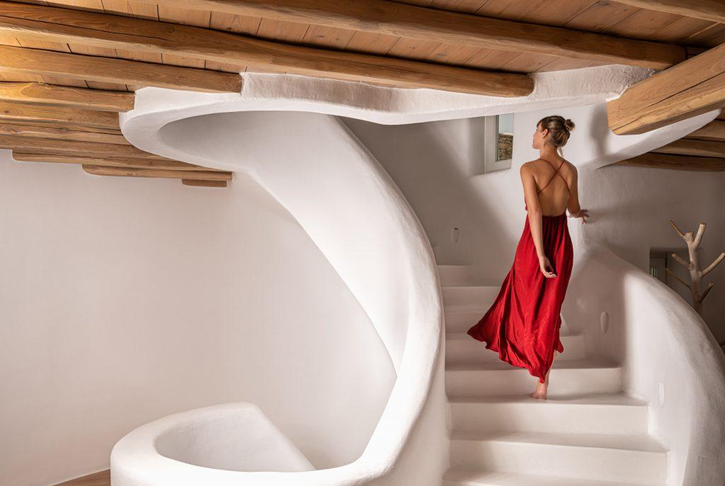 white coloured stairs with wooden roof