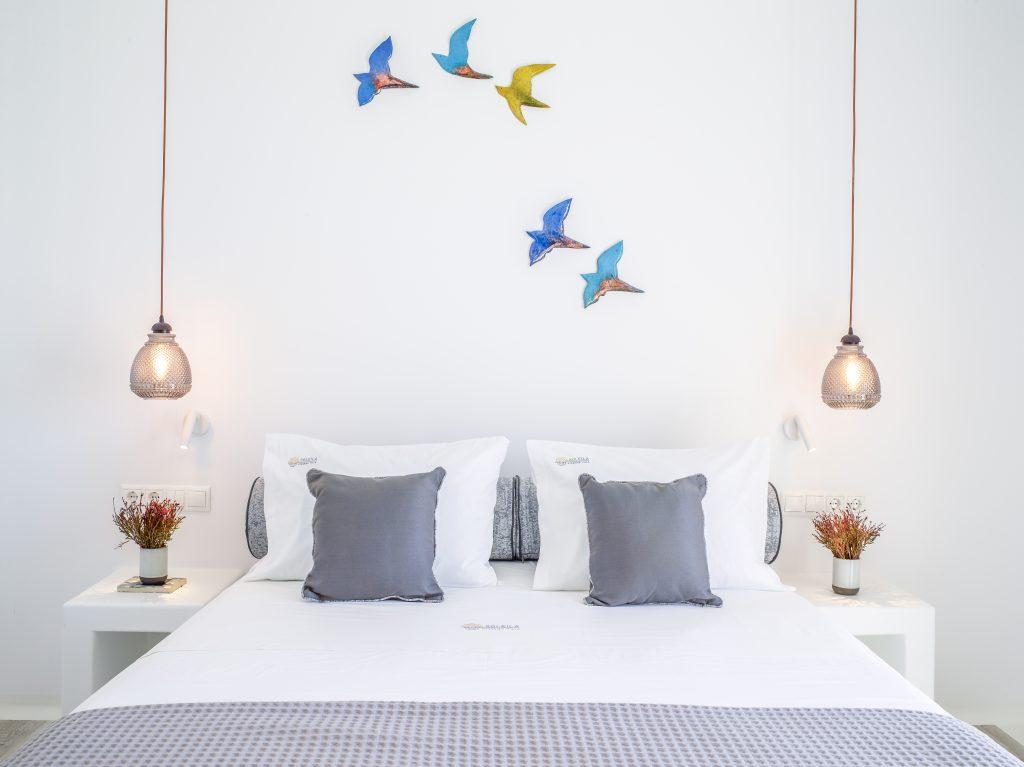 bedroom with hanging lamps and decorated walls