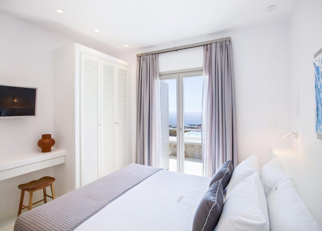 bedroom with white huge cabins and flat screen tv