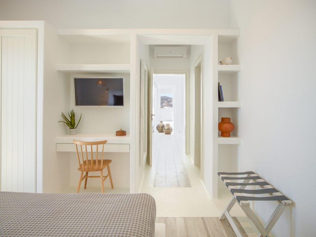 modern designed bedroom with bench and wall shelfs
