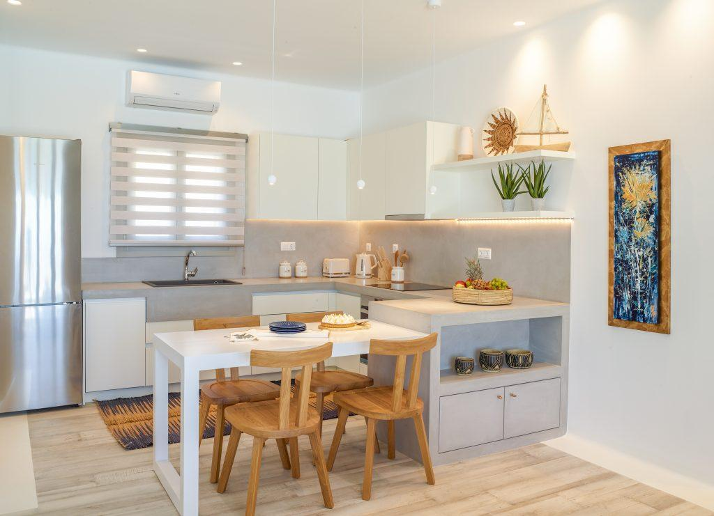 dining area with lit kitchen cabins