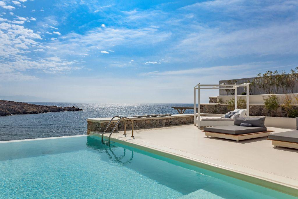 outdoor area with infinity pool and climber for sunbath