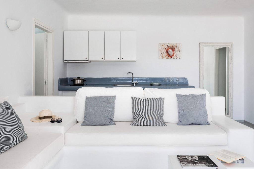 living area with comfort white bed and table