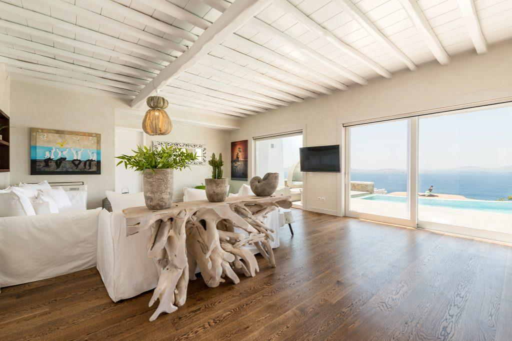 living room with large windows overlooking the dazzling blue sea