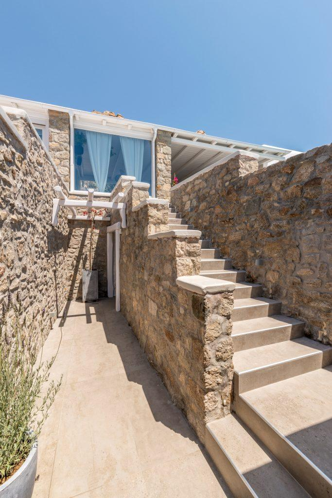 decorative stone staircase with beige tiles