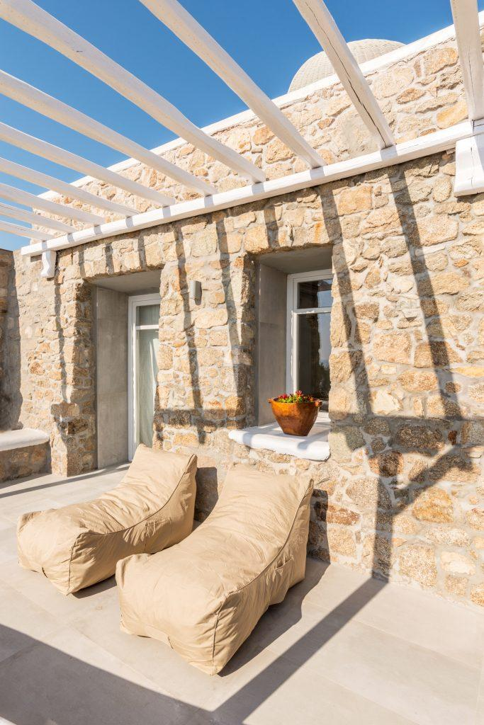 white wooden canopy that fits perfectly against the stone walls