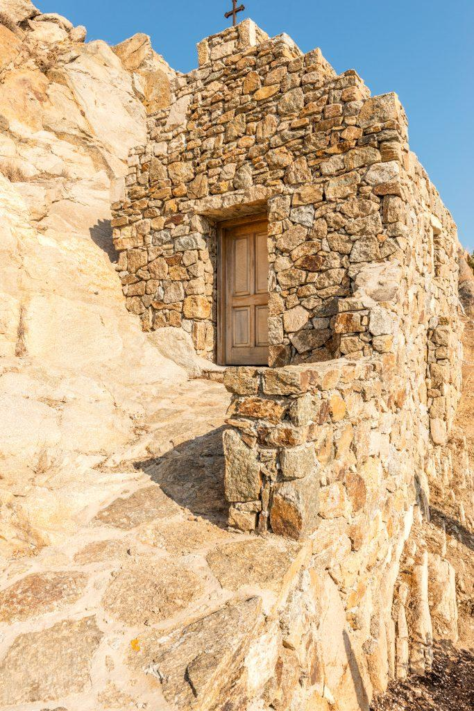 stone walls that fit perfectly next to a wooden door