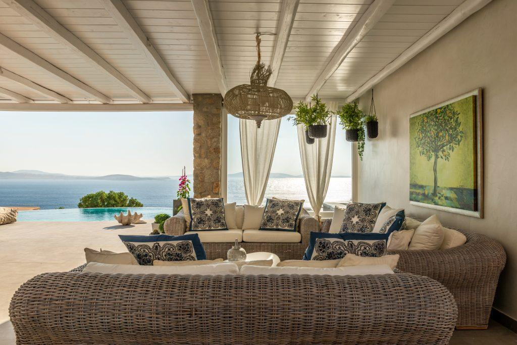 perfect view of the bright blue sea from the comfortable garden furniture