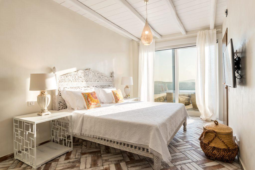 beautifully decorated bedroom with a comfortable bed