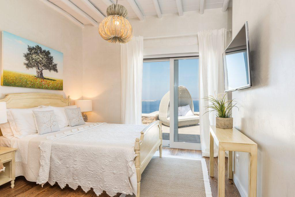 room with stylish furniture and views of the blue sea