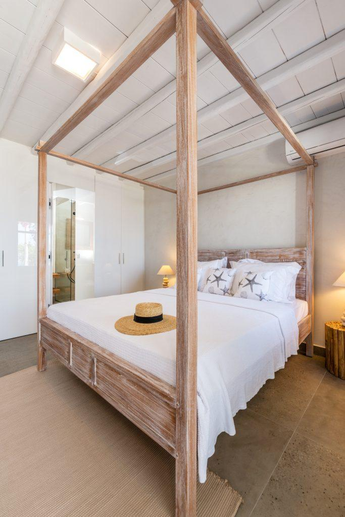 white walls of room with wooden king size bed