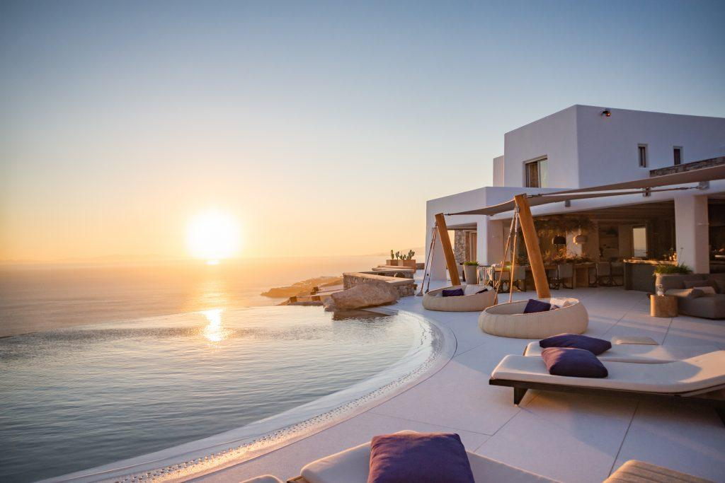 outside of the villa with breathtaking sunset and horizon view