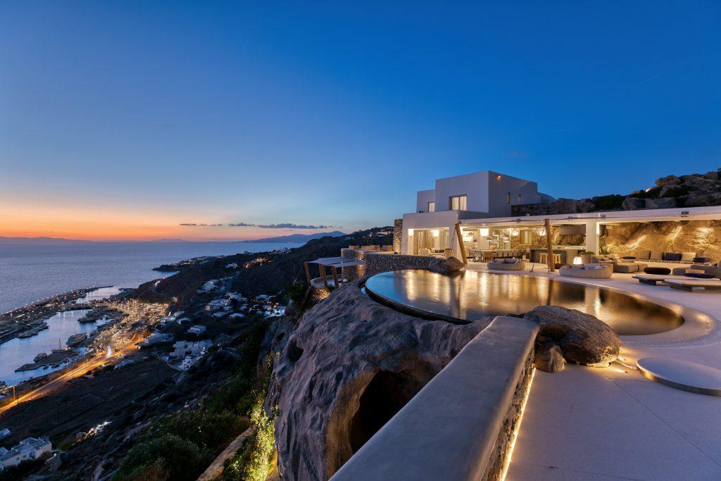 night view of villa exterior with beautiful sea view