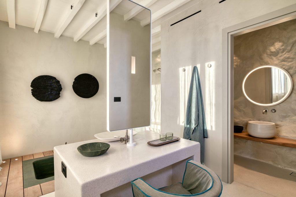 bathroom with huge mirror and candles