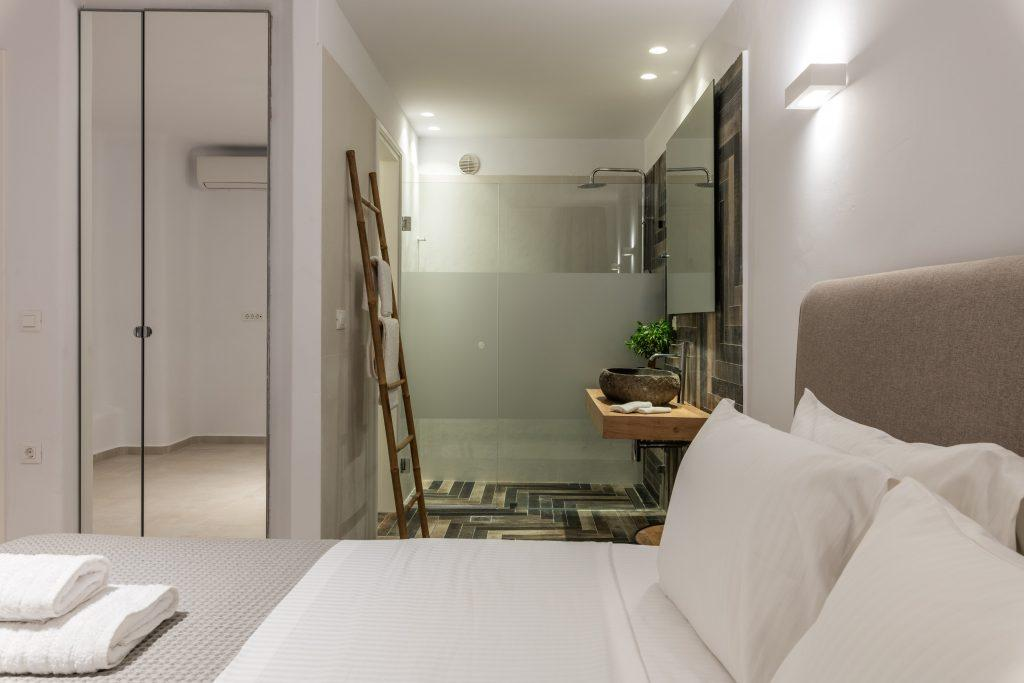 modern spacious bedroom with private bathroom