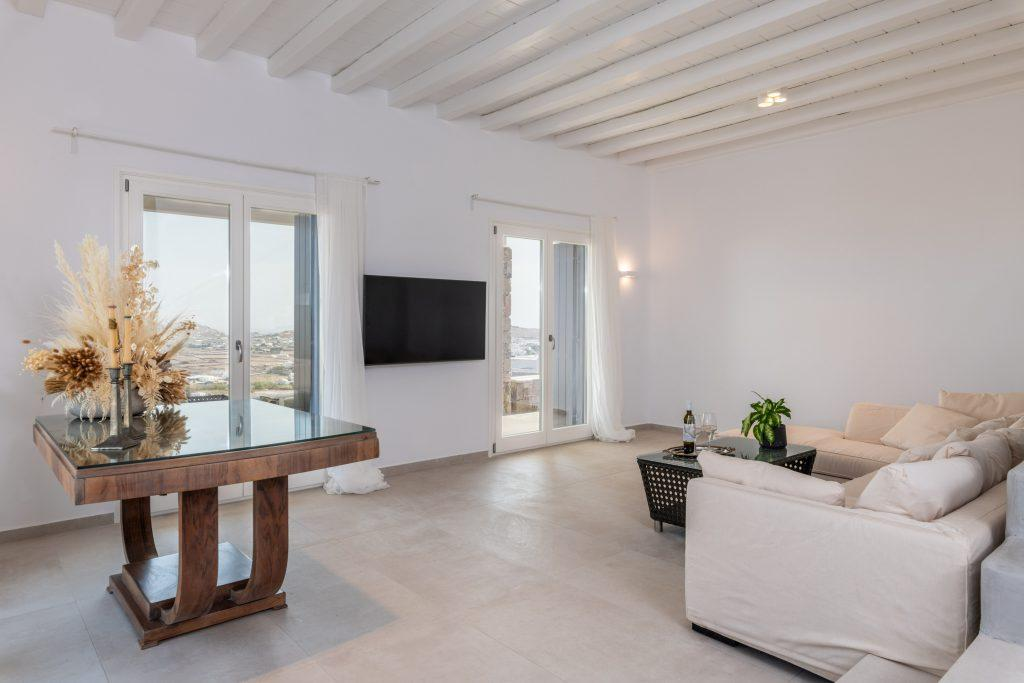 spacious living area with beautiful table and flat screen tv
