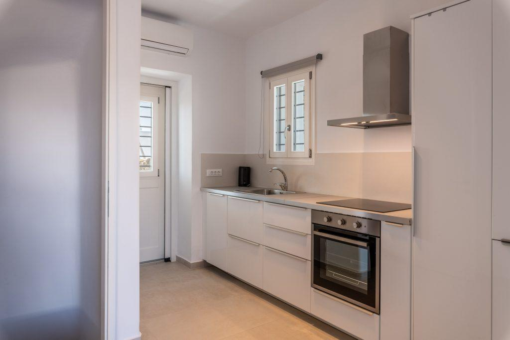 minimal designed kitchen with still oven and sink