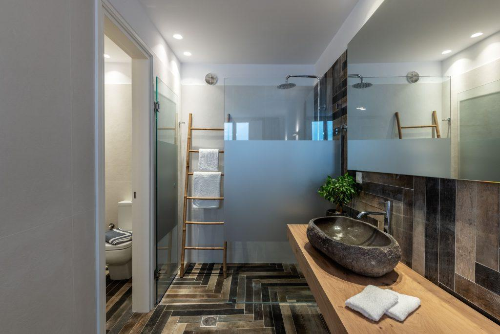 bathroom with soft towels and glass shower