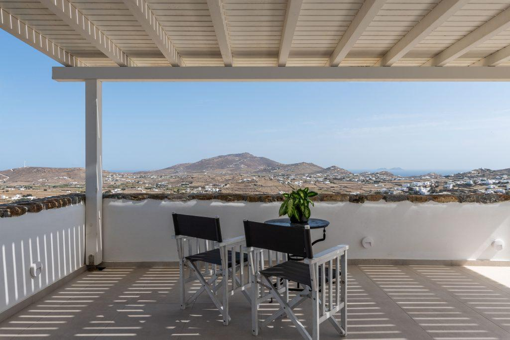 terrace with black chairs and small round table