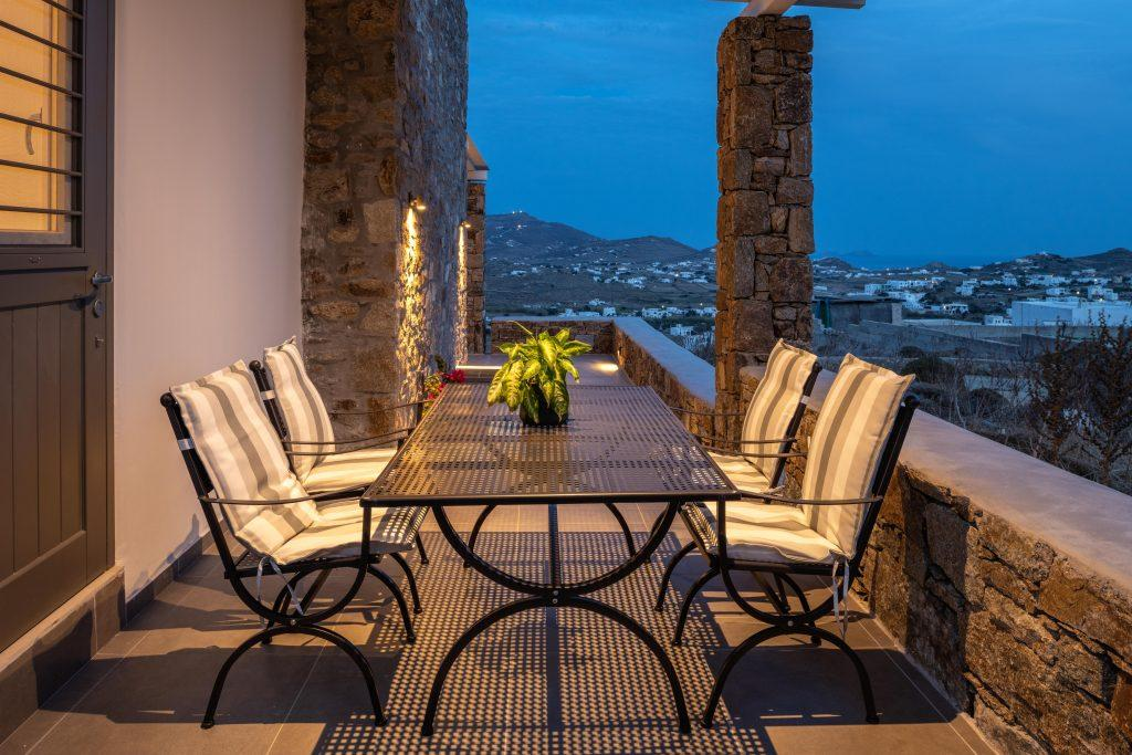 outdoor lit dining table and comfort chairs