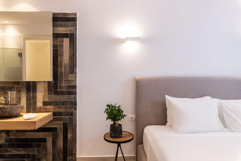 bedroom with comfort bed and night stand