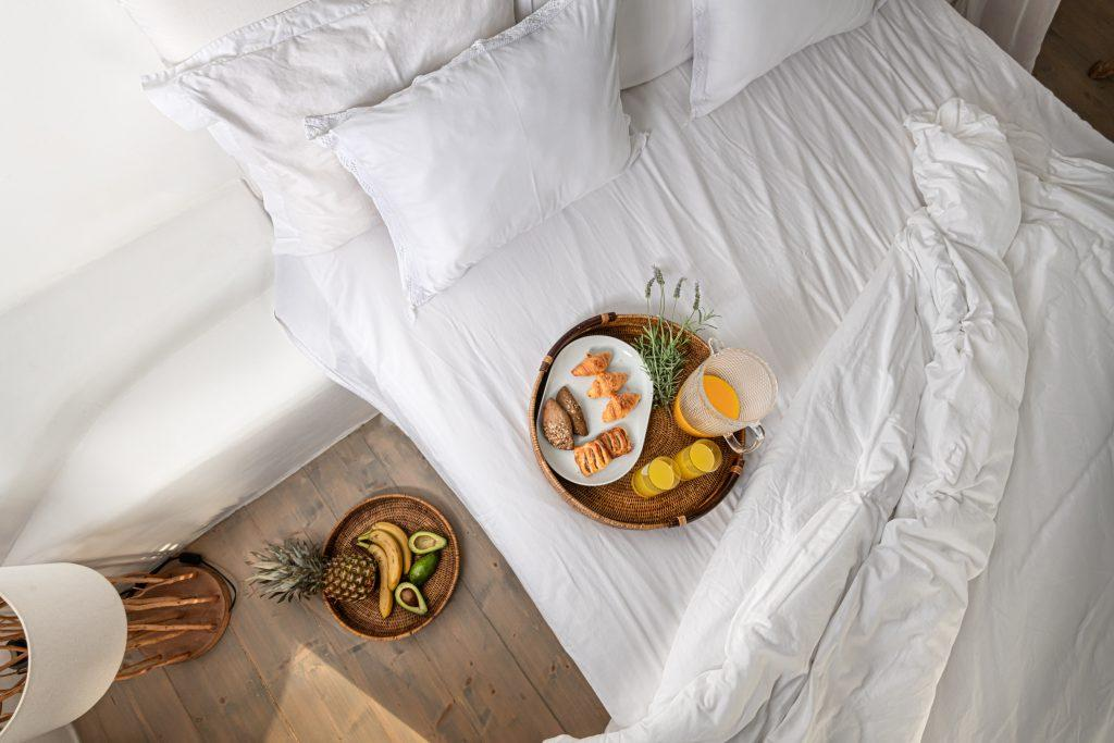 bedroom with comfort bed and food plate