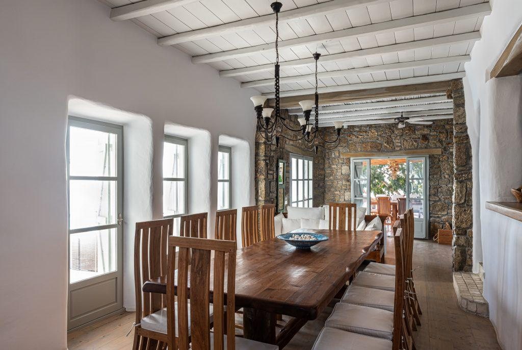 dining area with hanging lamp and wooden table