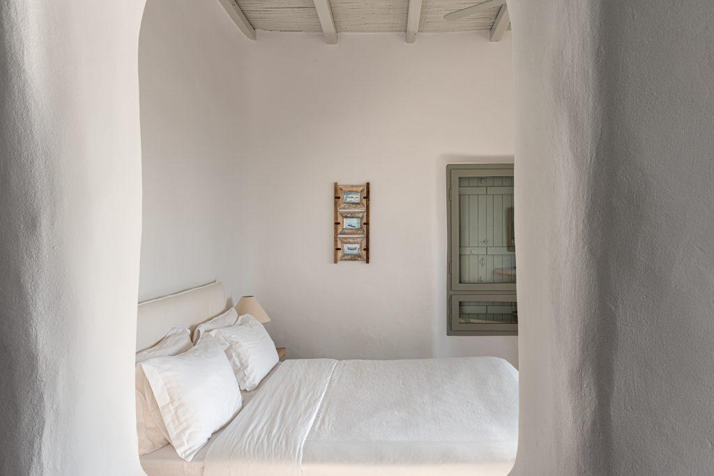 simply designed bedroom with white sheets