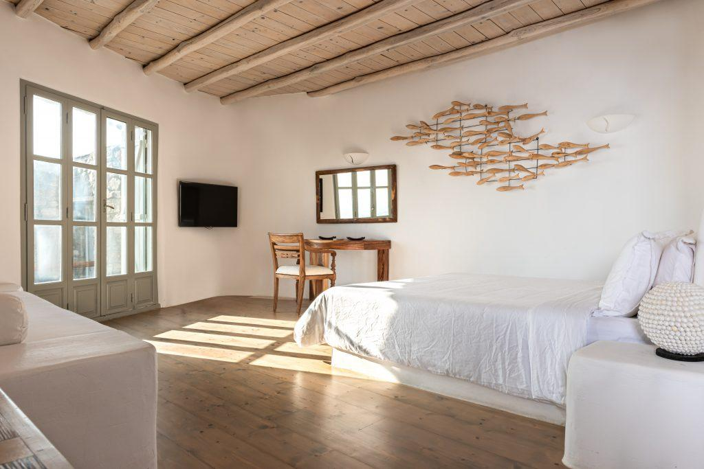 bedroom with comfort bed and wooden fish sculpture
