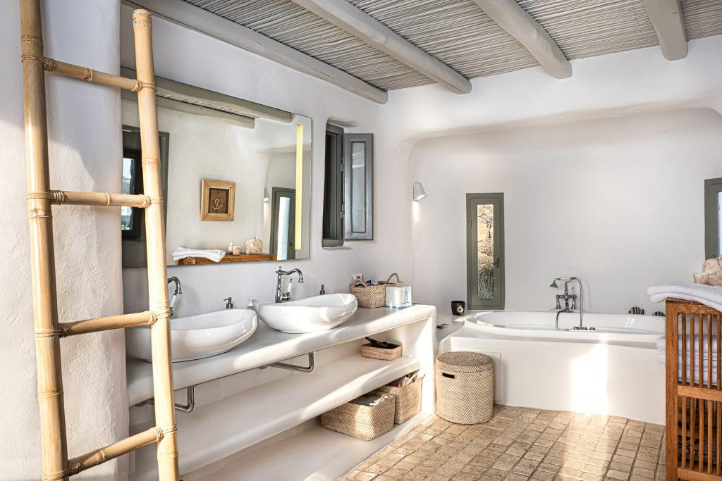 white wall bathroom with white ceramic sink and bath