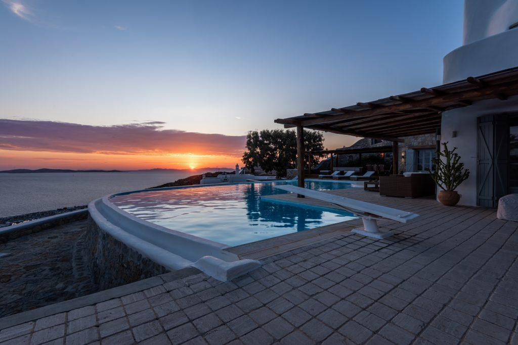 area with pool and romantic sunset view