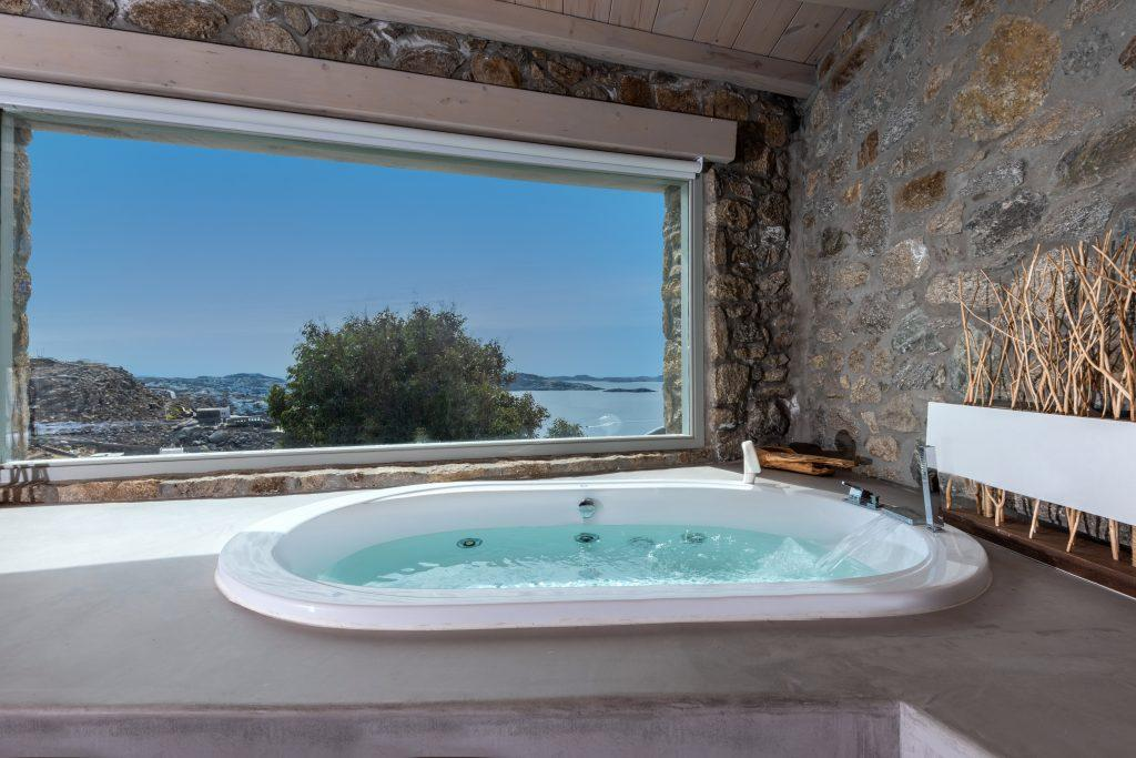 bathroom with jaccuzi to relax after hard day