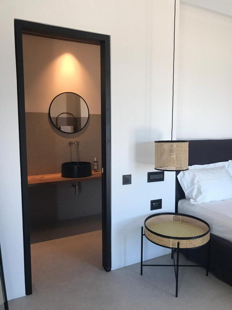 bedroom with night stand and lamp