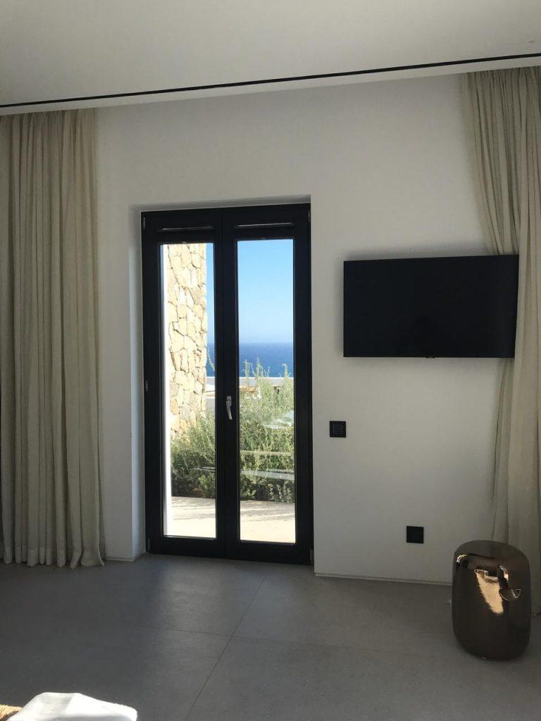 area with flat wall tv and terrace view