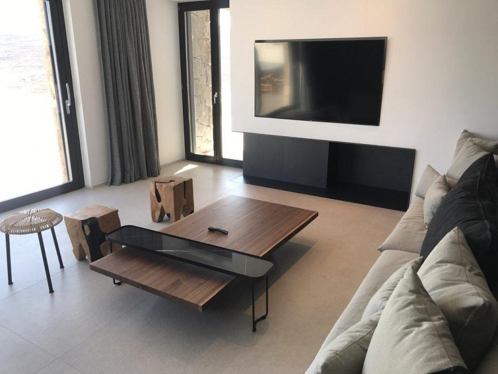 living area with wide tv and comfort couch