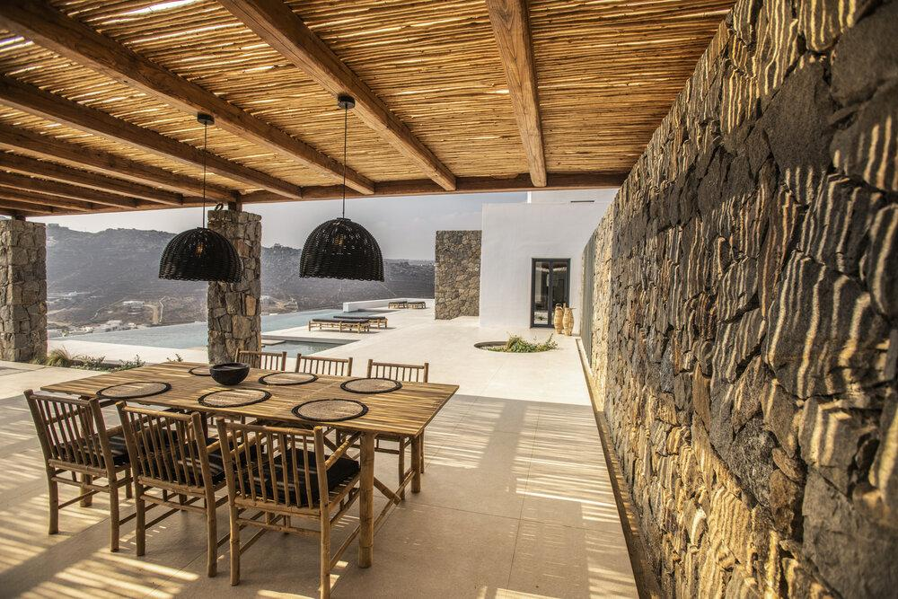 rocky wall dining area with roof to protect from the sun