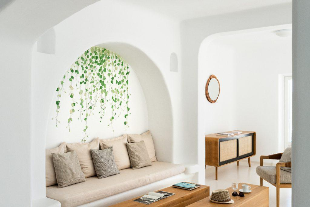 living area with comfortable sofa and cream coloured pillows