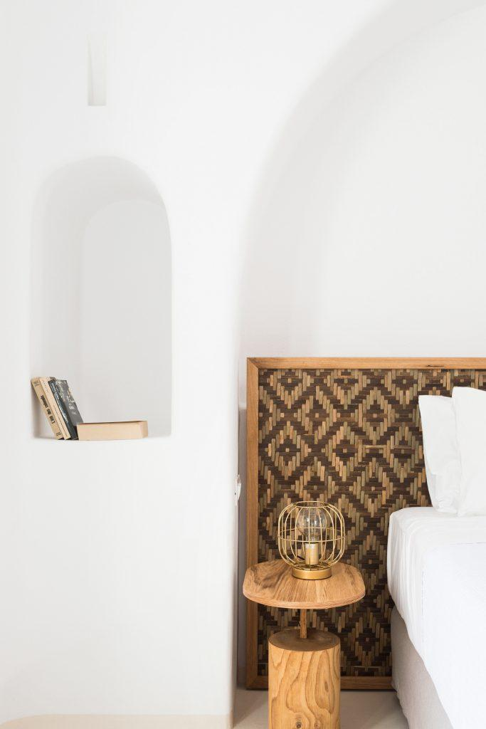 white wall bedroom with wooden nightstand and lamp