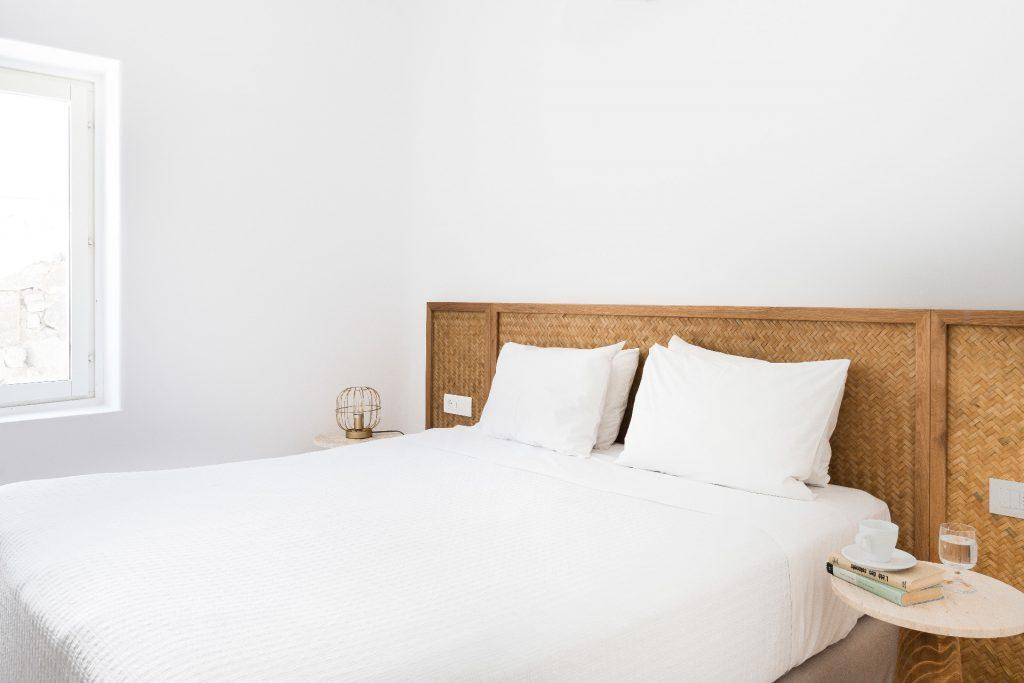 bedroom for relaxation with big bed and white soft pillows