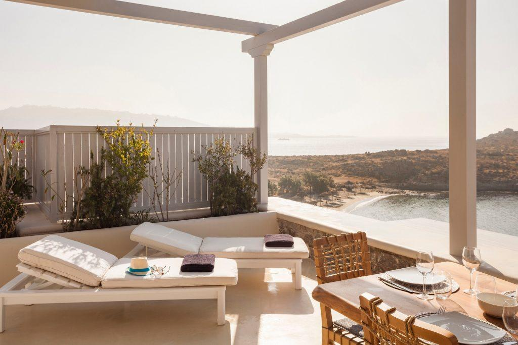 outdoor area with dining table and cozy climbers with sea view