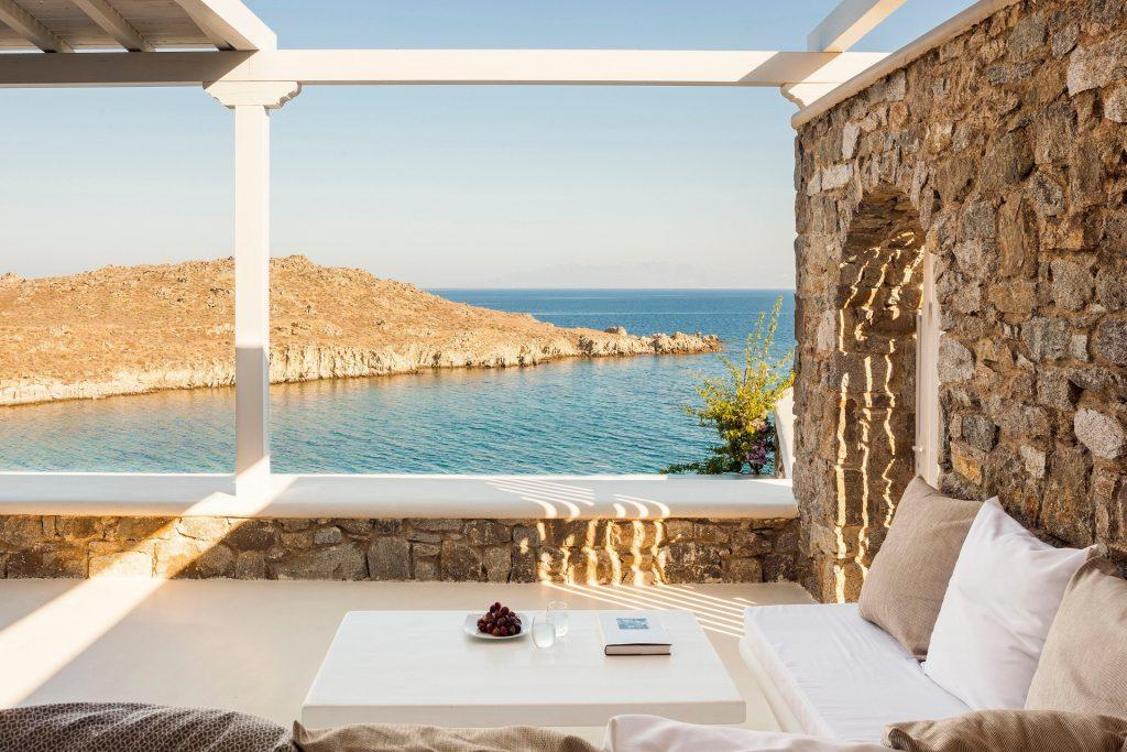 outdoor area with sofa and table with satisfying sea view
