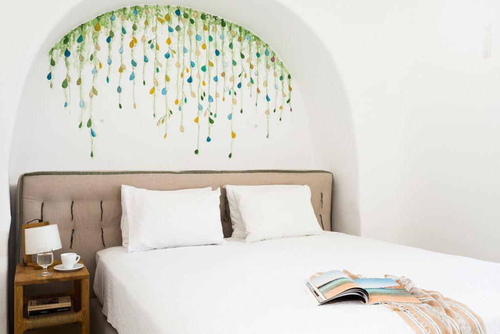 white wall bedroom with beautiful drawing above the bed