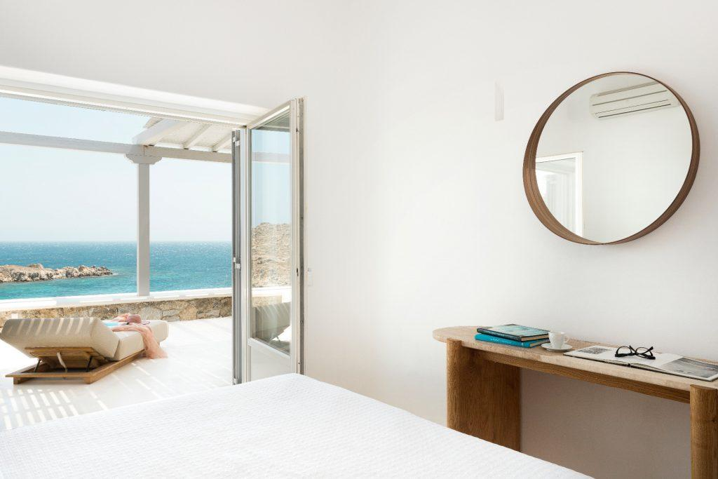 bedroom with big bed and breathtaking sea view from the windows