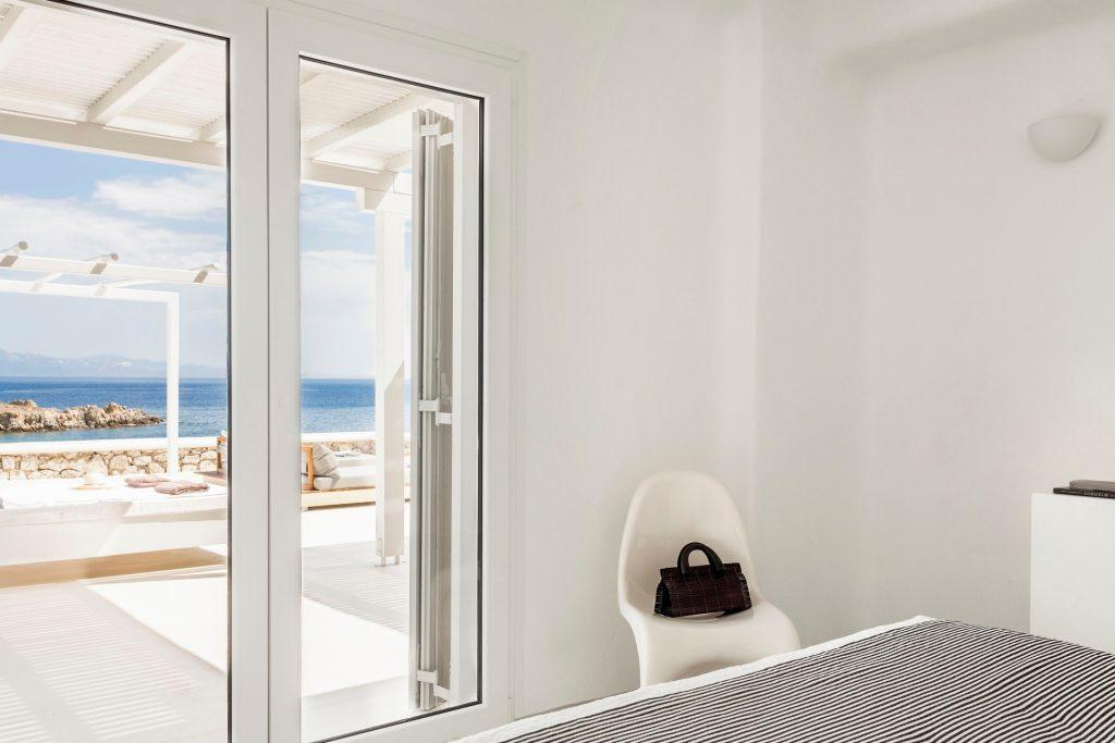 modern designed bedroom with satisfying sea view from the window