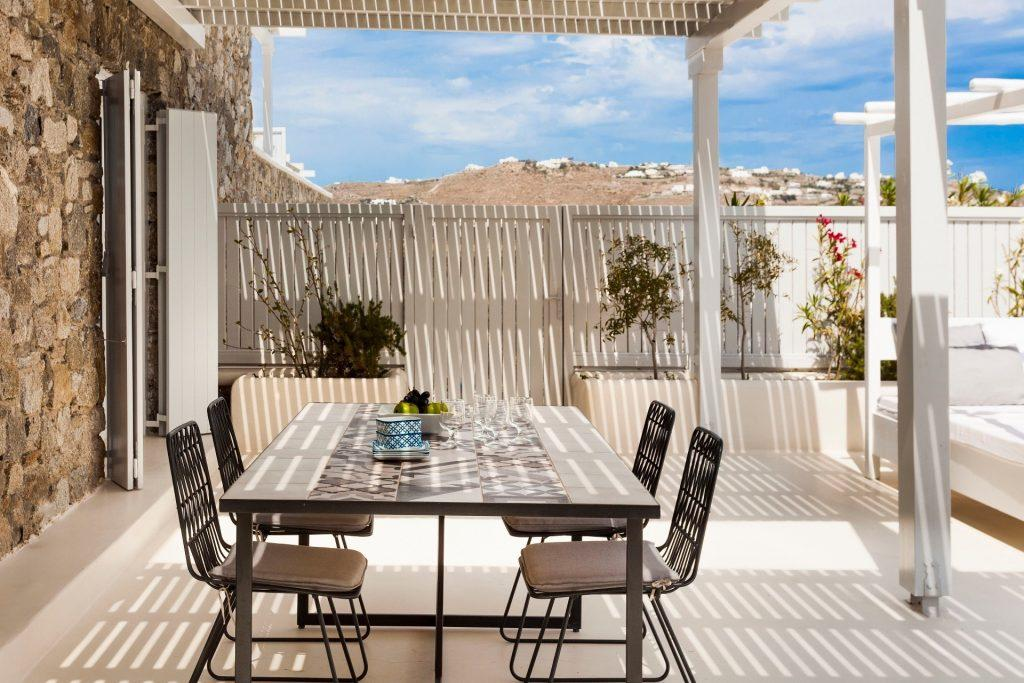 outside area with dining table to have beautiful meals