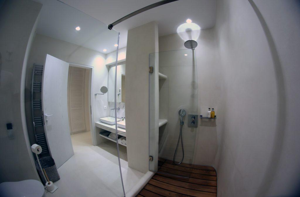 bathroom with glass shower and wooden floor