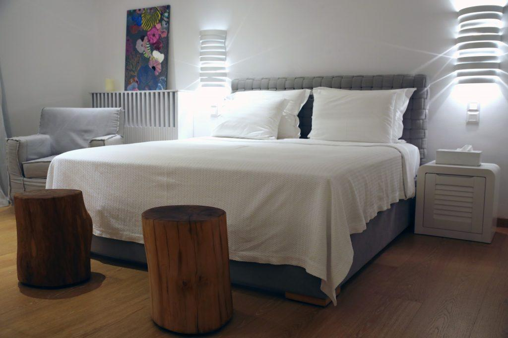 bedroom with nightstands and white sheets and lamps